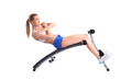 Sporty young woman on exerciser