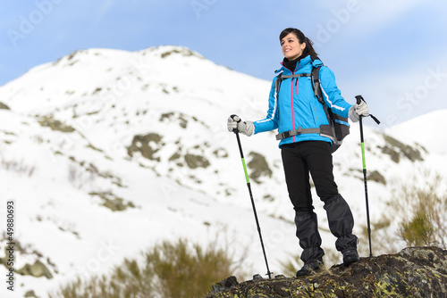 Woman hiking on winter mountain