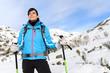 Woman hiking on snowy mountain
