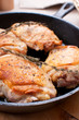 Fried chicken thighs in cast iron pan