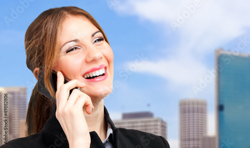 Young woman talking on the phone outdoor