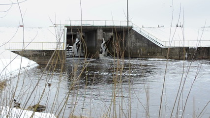 vintage brick river water dam car going top ducks swim winter