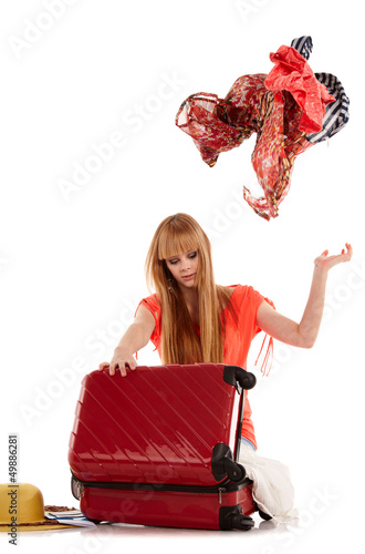 young girl with suitcase on white