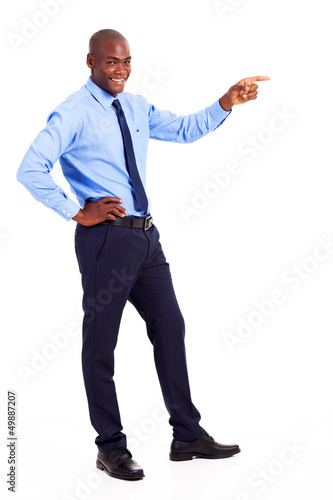 african businessman pointing at empty copyspace