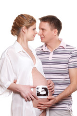 Happy pregnant family with ultrasound picture