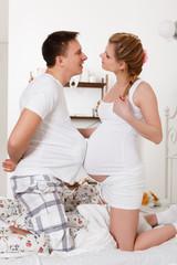 Happy pregnant family.