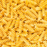 Italian Fusilli, Rotini or Scroodle Macaroni Pasta background