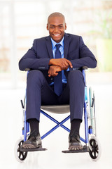 handicapped african american businessman sitting on wheelchair