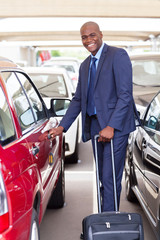 handsome african businessman in airport parking lot