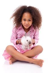 African Asian girl holding a rabbit