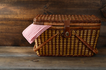 picnic basket on wood
