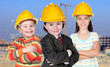Three future workers with a building construction