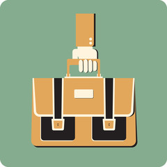 Retro style briefcase  in a hand