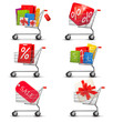 Collection of shopping carts full of shopping bags and gift boxe