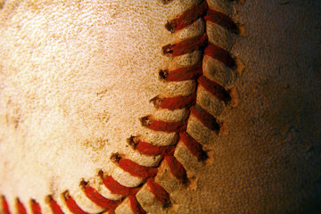 Closeup of an old, weathered baseball