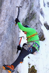 climbing an ice wall