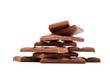 Stack of chocolate pieces on a white background.