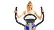 Pretty blonde training on exerciser close-up