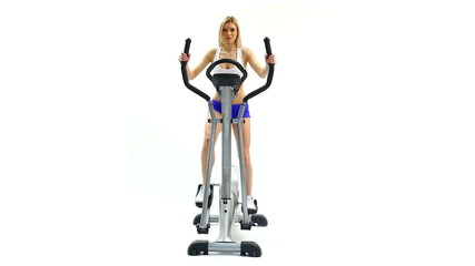 Attractive woman training on exerciser close-up