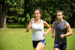 Jogging together - young couple competing