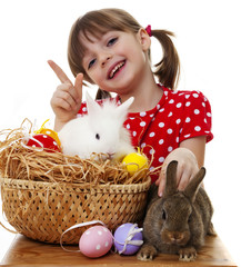 happy little girl with easter rabbits and eggs
