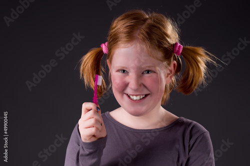 Pretty smiling Girl with Toothbrush
