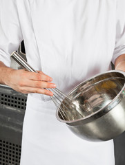 Chef With Wire Wisk And Mixing Bowl