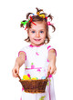 Girl holding basket with Easter decoration