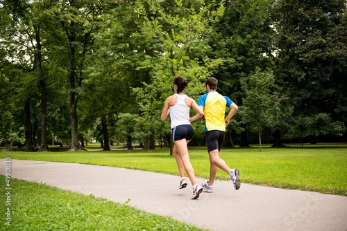 Jogging together - young couple running