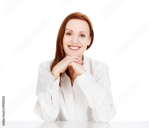 Happy business woman smiling to you, isolated on white.