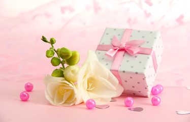 Beautiful romantic gift box and flower on pink background