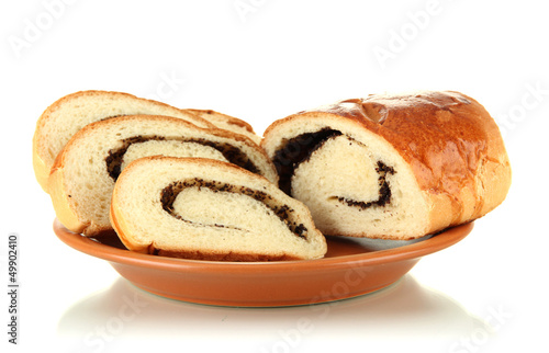 Loaf with poppy seeds on color plate, isolated on white