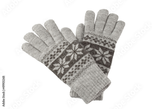 A pair of knitted winter gloves isolated on white background