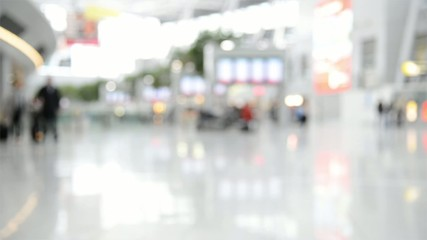 blurred commuters at an airport