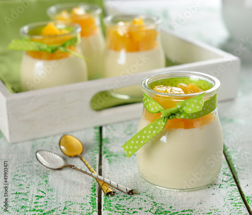 Italian dessert panna cotta with peaches