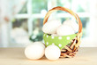 Many eggs in basket on table in room