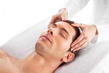 Closeup of a man having a head massage