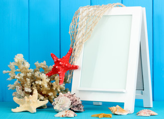 White photo frame for home decoration on blue background