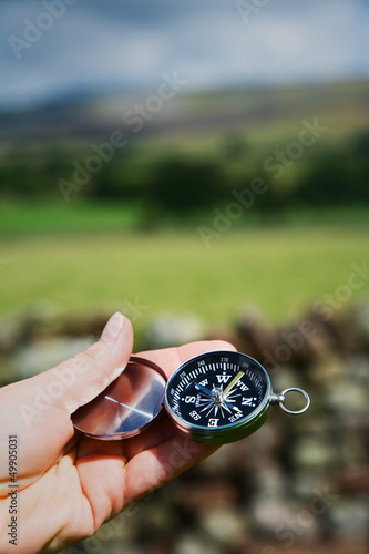 Hand Holding Compass in Rural Setting
