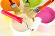 Set for painting: paint pots, brushes, paint-roller