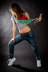 hip hop dancing girl on a dark background