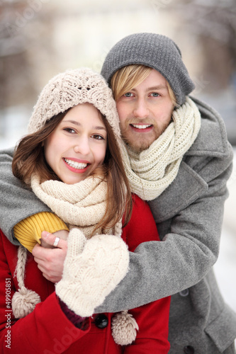 Couple in Winter Clothing Embracing