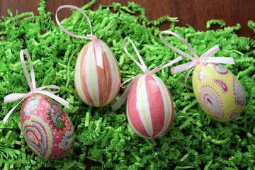Decoupage eggs on green paper grass