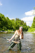 woman fishing in river, Czech Republic