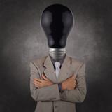 businessman with black light bulb head poster