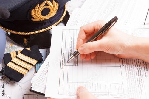 Airplane pilot filling in flight plan