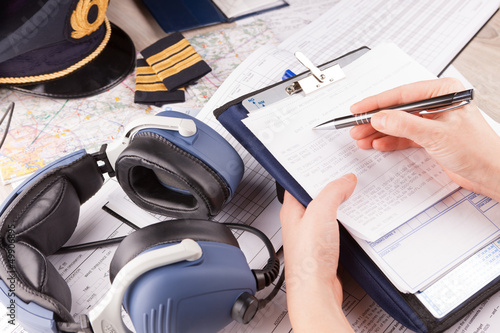 Airplane pilot filling in flight plan - 49906895