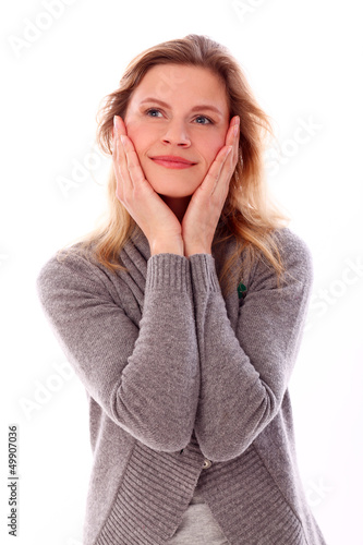 Beautiful caucasian woman with hands on face