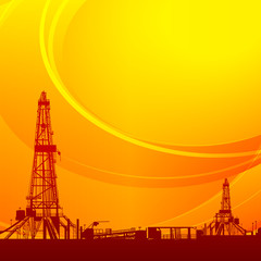 Oil rig silhouettes and orange sky