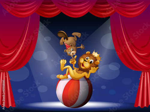 A lion and a beaver performing at the stage